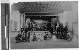 Actors on stage in conference hall of Tsumatsukurei, Osaka, Japan, ca. 1909