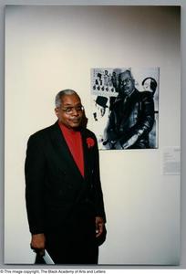 [Allison Tucker standing in front of his portrait] Dallas/Fort Worth Black Living Legends