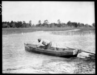 Mose Moultrie bailing out boat