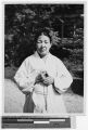 Portrait on an elderly Korean woman holding a rosary, Japan, ca. 1937
