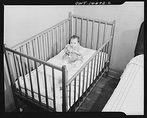 Detroit, Michigan. Negro baby in a crib. These are conditions under which families originally lived before moving to the Sojourner Truth housing project