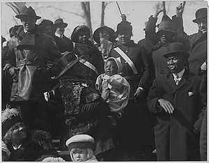 Relatives and friends cheering the 369th Infantry as they pass in parade. New York City's [African...