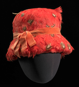 Red feather lamp shade hat from Mae's Millinery Shop
