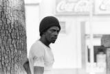 African American man watching a United Klans of America march in Mobile, Alabama.