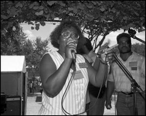 [Female Member of the Voices of Zion Community Choir Performing] 18th Annual Texas Folklife Festival