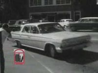 WSB-TV newsfilm clip of civil rights movements and Albany city officials entering the Federal Building in Albany, Georgia, 1962 July