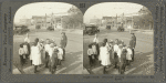 Traffic Policeman Helping Children to Cross the Street