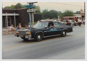 [Police Car in a Parade] Albert Kiecke Scrapbook 1