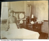 African-American woman working with cloth or bandages, Indianapolis, Indiana, ca. 1906