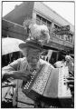 Casey Jones, also known as Chicken Charlie, playing the accordion on Maxwell Street, east of Halsted Street