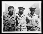 [Three members of the ground crew with the 99th Fighter Squadron]