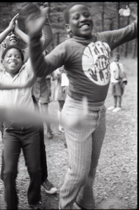 Inner City Round Table of Youth campers: group of African American children at summer camp, leaping in air, arms raised