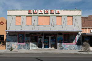 """This old vaudeville house, built in the 1930s in Alpine, Texas, was purchased by Indian immigrant Avanish Rangra, a chemistry professor at Sul Ross State University locally, and his wife, Anju, in the 1970s. In 2002 their son, Amit, told a local newspaper, """"We're not exactly a multiplex as much as a 'biplex'"""" movie theater. At one time, the upper windows were also covered with depictions of Hollywood movie stars"""