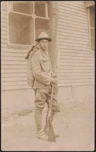 [Unidentified African American soldier in uniform, cartridge belt, and campaign hat with bayoneted rifle and knapsack]