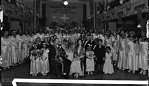 [Daddy Grace and a group of men, women and children inside a House of Prayer for All People : cellulose acetate photonegative, banquet camera format]
