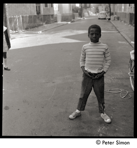 African American boy standing in the street