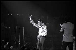 Richard Nader's Rock and Roll Revival concert at the Springfield Civic Center: Chubby Checker waving to crowd at end of performance