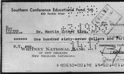 Mississippi State Sovereignty Commission photograph of a bank check from the account of Southern Conference Educational Fund written to Martin Luther King, Jr. and signed by Benjamin E. Smith and James A. Dombrowski, New Orleans, Louisiana, 1963 March 7