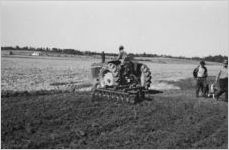 African American man on tractor