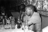 Robert Flowers and others, seated at a table at a club, probably in Montgomery, Alabama.