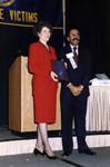 Jackye McClure holds a plaque