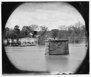 [Richmond, Va. Ruins of Richmond & Danville Railroad bridge; the city beyond]