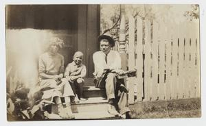 [African American Family Sitting on Porch Steps]