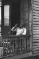 Jasper Wood Collection: Man on porch drinking beverage