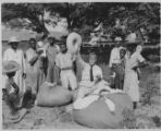 Photograph. Senator Ellison Smith with African-American sharecroppers and cotton.