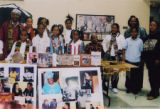 Eugene Redmond with a group of children
