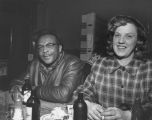African-American man socializing over a beer with a friend, ca. 1950's