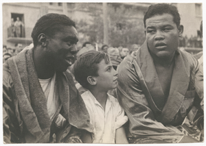 Photographic print of Joe Louis with an unidentified man and boy