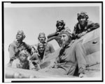 [Seven pilots(?) on airplane, Tuskegee Army Air Field, Alabama]