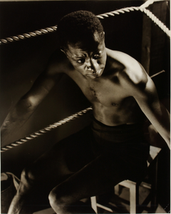 Unidentified boxer sitting in ring