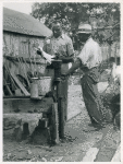 An FSA [Farm Security Administration] supervisor consults a borrower about unsanitary water supply; Safe well demonstration, near La Plata, Maryland [Charles County,] July 1941