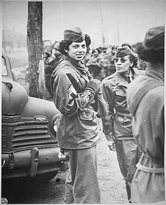 """""""The `Top-Kick' looks them over at Camp Shanks, New York, Transportation Corps staging area of the New York Port of Embarkation. Tech. Sgt. Tommye Berry, Acting 1st Sgt. of the Negro WAC group..."""""""