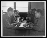 Thumbnail for American soldiers of many races mess together and work on very close terms at a U.S. Army Quartermaster Supply Depot, Somewhere in England