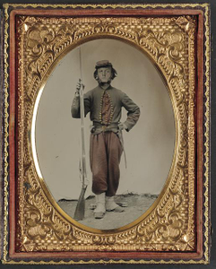 [Unidentified soldier in Union zouave uniform with bayoneted musket with initials A.T. on stock]