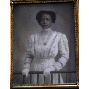African American woman clasping a railing