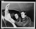Heads Link Trainer Sect. at TAAF Lt. William R. Walls, head of the Link Trainer Section at the Tuskegee Army Air Field shows Aviation Cadet Carroll H. Robinson of Atlanta, Georgia how to check his instrument panel while flying under adverse weather conditions.