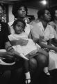 Women in the audience at Brown Chapel AME Church in Selma, Alabama, listening to a speaker during a civil rights meeting.