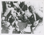 Paratrooper from the 101st Airborne Brigade applying mouth-to-mouth resuscitation to an injured soldier who was airlifted by helicopter to the medical clearing station near Kontum, Vietnam