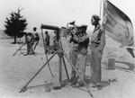 Men taking machine-gun instruction