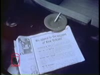 Series of WSB-TV newsfilm clips of a paid newspaper advertisement urging community support for the Orleans Parish School Board and white demonstrators protesting court-ordered desegregation at McDonogh 19 and William Frantz elementary schools in New Orleans, Louisiana, 1960 November and December