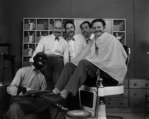 [Four men and one man in blackface on barbershop set] NBC News Photographs