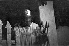 """Scene from the morality play """"Heaven Bound,"""" staged by the Big Bethel African Methodist Choir, at the Atlanta Theatre (23 Exchange Place), Atlanta, Georgia, August 1937"""