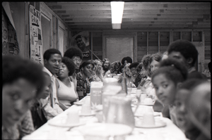 Inner City Round Table of Youth campers:group of African American campers at dining table (adults at end)