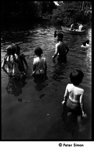 Children wading in the pond at Jackie Robinson's jazz concert