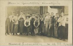 "Informal Group photo with handwritten annotation ""Class in Quantitative Analysis Chemical Laboratory U of M 5/16/1910"""
