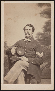 [Sergeant Matthew Henry Huxley of Co. C, 2nd Connecticut Heavy Artillery Regiment in uniform in front of painted backdrop]